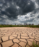 Stormy Clouds And Cracked Land royalty free stock image