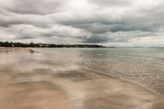 Stormy clouds gathering above beach in Takapuna Stock Photo
