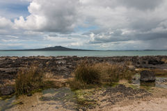 Stormy clouds gathering above Rangitoto Island Stock Images