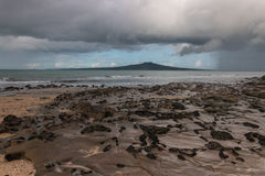 Stormy clouds gathering above Rangitoto Island Royalty Free Stock Photo