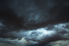 Stormy clouds gray sky with dramatic shadows Stock Images