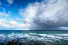Stormy clouds and heavy rain on a sea. Stormy clouds and rain on a sea royalty free stock photo