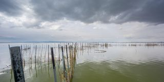 Stormy clouds over Albufera natural park, Valencia Royalty Free Stock Images