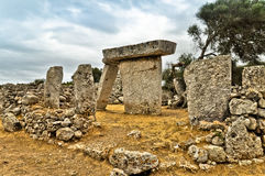 Stormy clouds over ancient megalith, Minorca Royalty Free Stock Images