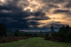 Stormy clouds over New Forest countryside stock photos