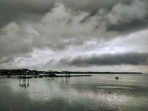 Stormy clouds over kelong. A kelong or kellong; is an offshore platform built predominantly with wood, which can be found in waters off Malaysia, the stock images