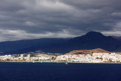 Stormy clouds over Los Cristianos resort in Tenerife Royalty Free Stock Photography