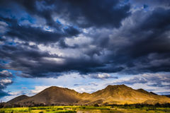 Stormy clouds over mountains Stock Photo