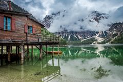 Stormy clouds over Pragser Wildsee lake in Dolomites Royalty Free Stock Photography