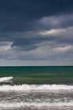 Stormy clouds over the sea Stock Photos