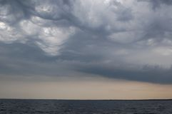 Stormy clouds over sea. Shot from a yacht Royalty Free Stock Photography