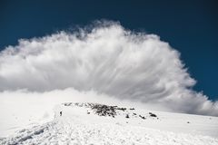 Stormy clouds overhang over the snow-capped mountain Elbrus Royalty Free Stock Photography