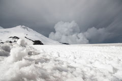 Stormy clouds overhang over the snow-capped mountain Elbrus Stock Photography