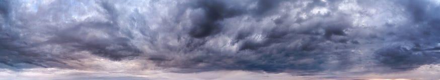 Stormy clouds panorama. Stormy dark blue clouds panorama stock image
