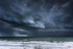 Stormy clouds and rain on sea. Stormy clouds and rain on the sea stock photos