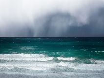 Stormy clouds and rain on a sea. With waves royalty free stock photos