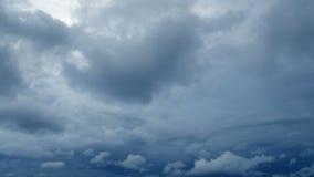 Dramatic storming dark rain clouds on sky timelapse.