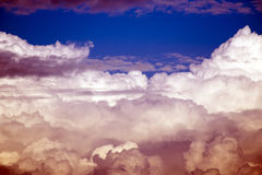 STORMY CLOUDS. With beautiful colours at sunset royalty free stock photo