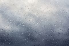 Stormy clouds through the wet window Royalty Free Stock Images