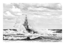 Stormy cloudy day. Dramatic sky and huge waves at the Lighthouse, Ahtopol, Bulgaria royalty free stock images