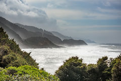 Stormy coastline in Oregon with fog and white ocean beach Royalty Free Stock Photography