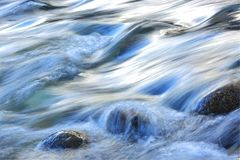 Stormy current of a mountain river. Royalty Free Stock Image