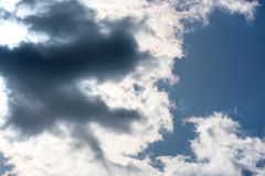 Stormy dark-blue sky with a dramatic sunbeam.  Stock Photography