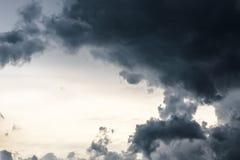 Stormy dark-blue sky with a dramatic sunbeam.  Stock Image