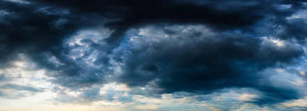 Stormy dark blue cloudy sky. High resolution panorama. Stock Photo