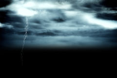 Stormy dark sky with lightning bolt Stock Image