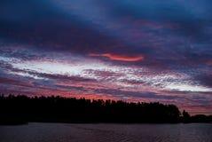 Stormy dark sky in red sunrise colors Stock Photo