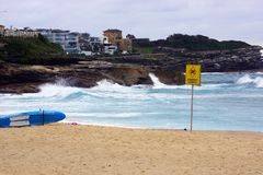 Wild Surf at Stormy Bronte Beach, Sydney, Australia. A stormy day at Bronte Beach in Sydney`s Eastern Suburbs, with wild and rough waves and churned up Pacific Royalty Free Stock Photography