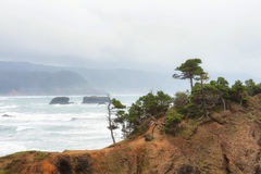 Stormy day at Pilot Rock on Oregon Coast Royalty Free Stock Photo