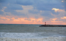 Stormy day on the sea. On the sunset Stock Image