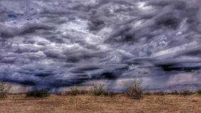 Stormy Desert. A rain storm in the Mojave Desert royalty free stock photo