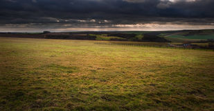 Stormy dramatic cloud formations above landscape Royalty Free Stock Photography