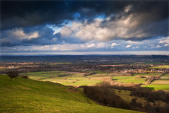 Stormy dramatic cloud formations above landscape Stock Photo