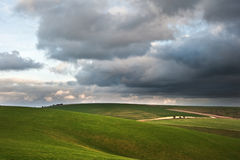 Stormy dramatic cloud formations above landscape Stock Image