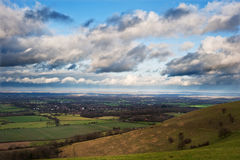 Stormy dramatic cloud formations above landscape Royalty Free Stock Images