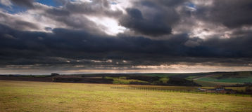 Stormy dramatic clouds above countryside landscape Royalty Free Stock Images