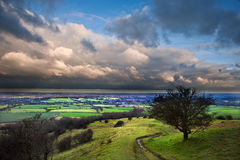 Stormy dramatic clouds above countryside landscape Royalty Free Stock Image