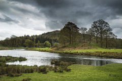 Stormy dramatic sky over Lake District countryside landscape Royalty Free Stock Photos