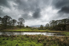 Stormy dramatic sky over Lake District countryside landscape Stock Photos