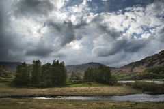 Stormy dramatic sky over Lake District countryside landscape Royalty Free Stock Photography