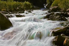 Stormy and frothy mountain stream Royalty Free Stock Images