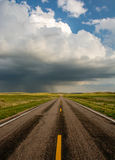 Stormy Highway in the Sandhills. An incoming storm seems to stand as welcome for those traveling those lonely highway in the sandhills of Nebraska Stock Photography