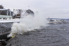 Stormy lake quay in winter Royalty Free Stock Image