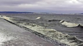 Stormy lakeside park in winter stock video footage
