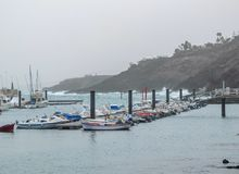 Stormy Marina Lanzarote Spain through a Sea Spray Mist in December stock photo
