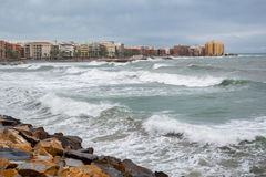 Stormy Mediterranean sea, city beach of Torrevieja Stock Images
